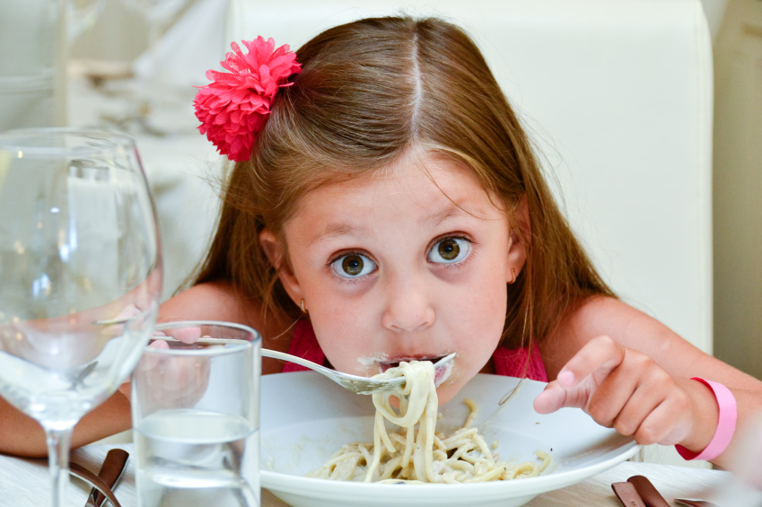 Cute girl eating pasta