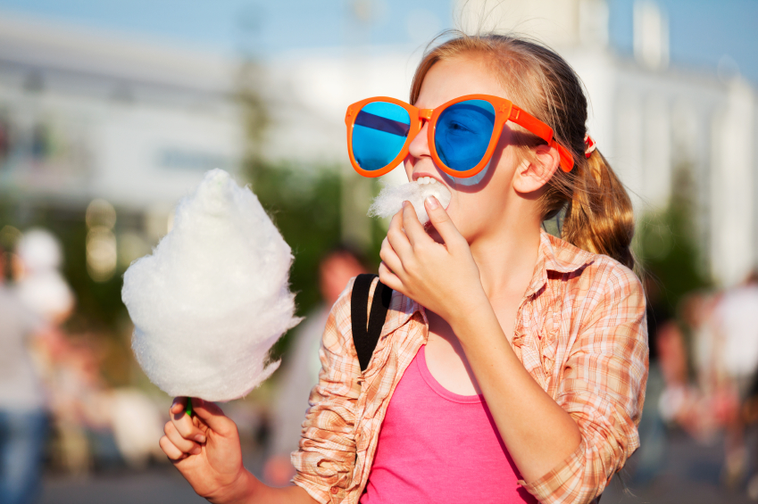 Girl eating cotton candy zucchero filato