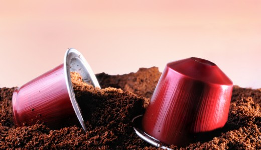 Capsules for espresso coffee machine on heap of ground coffee