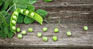 Peas on wooden board