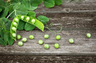 Peas on wooden board