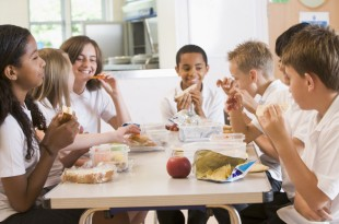 Schoolchildren enjoying their lunch in a school cafeteria