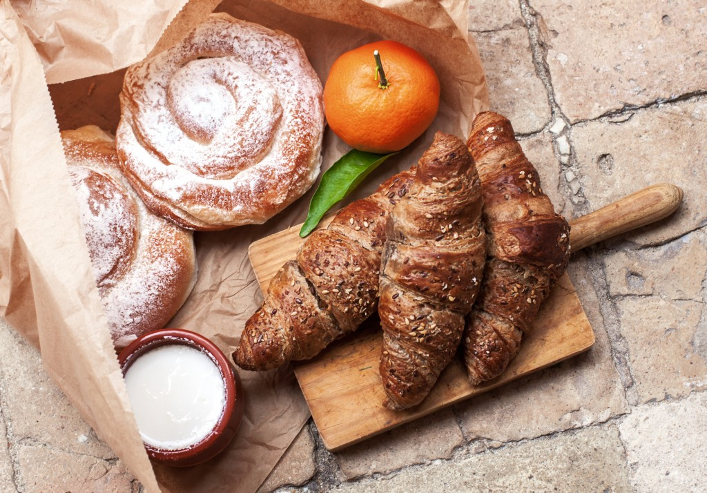 Freshly baked croissants and ensaimada a pastry typical of Mallorca, Spain