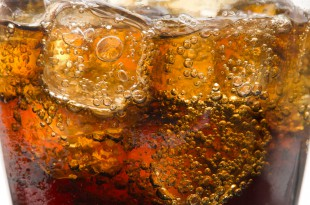 Glasses with soda and ice cubes