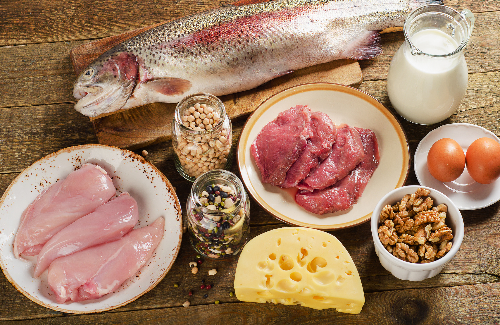 Food high in protein on a wooden background.