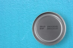 manufacture date and expiry date printed on the bottom of aluminum cans on blue cement table background, Information of for consumer, top view