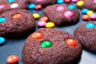 Chocolate cakes made by children. Cookies with colorful candies