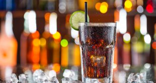 Glass of cola on bar desk