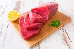 Raw tuna steak on wooden cutboard