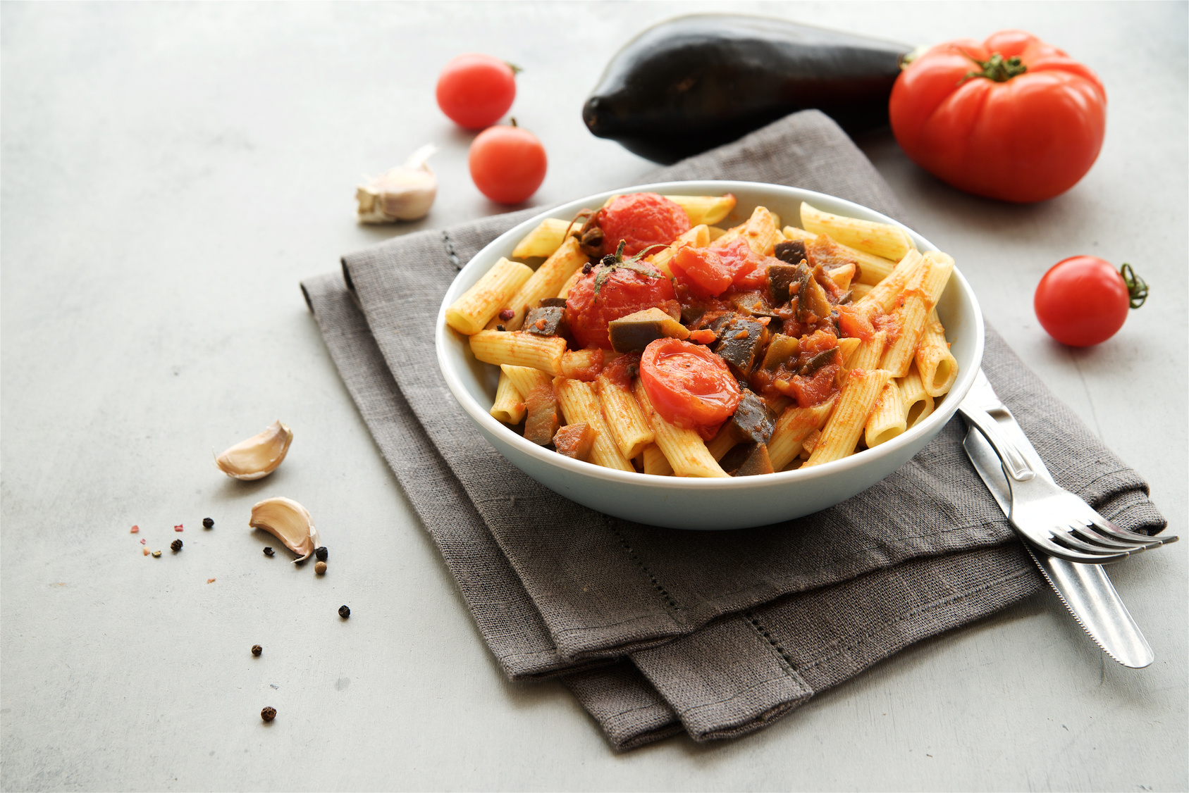 Penne pasta with tomato sauce, garlic and eggplant