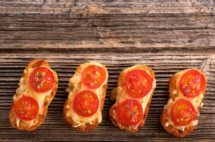 Grilled toast with cheese and tomatoes