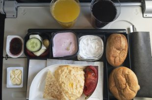 Airplane interior treat breakfast for economy service