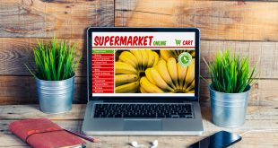 Supermarket grocery online shop in a laptop screen at the office