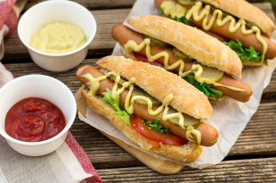 Wurstel Hot dog in a bun with mustard and vegetables