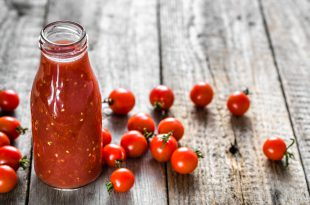 Bottle of tomato juice and fresh tomatoes, organic healthy food concept