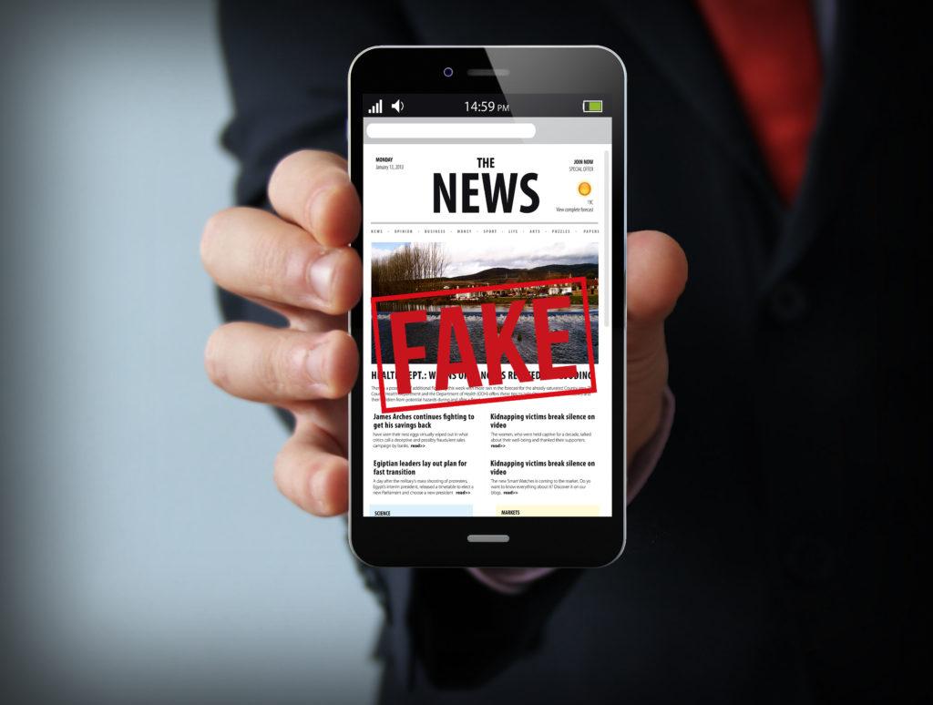 fake news businessman smartphone