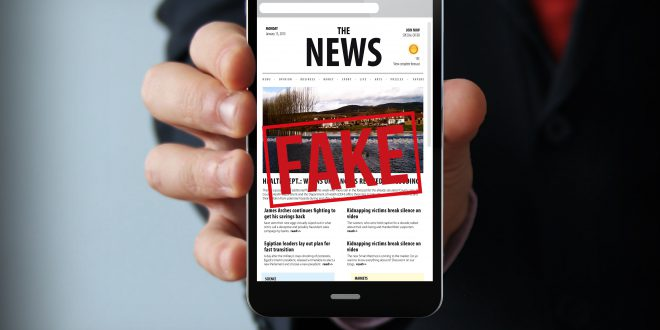 fake news businessman smartphone coronavirus