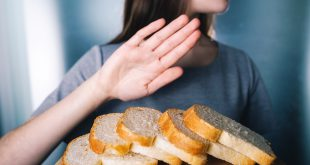 Gluten intolerance concept. Young girl refuses to eat white bread - shallow depth of field
