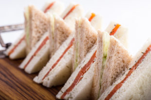 English tea sandwiches platter on wooden board