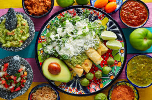 Green enchiladas Mexican food with guacamole