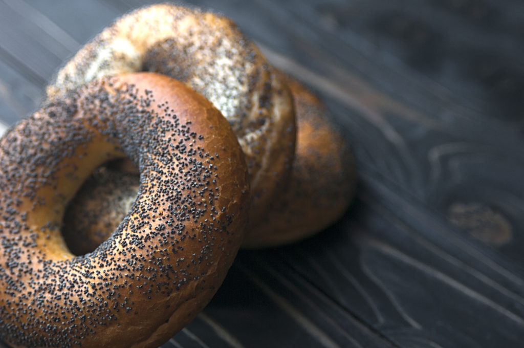 Fresh bagel with poppy seed. Russian traditional bakery product. For bakery pastry banner, ad, poster.