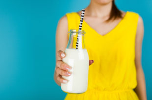Woman holding a bottle of milk