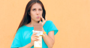 Woman Suffering Toothache After Eating Chocolate