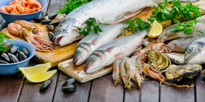 Raw seafood on a wooden board.