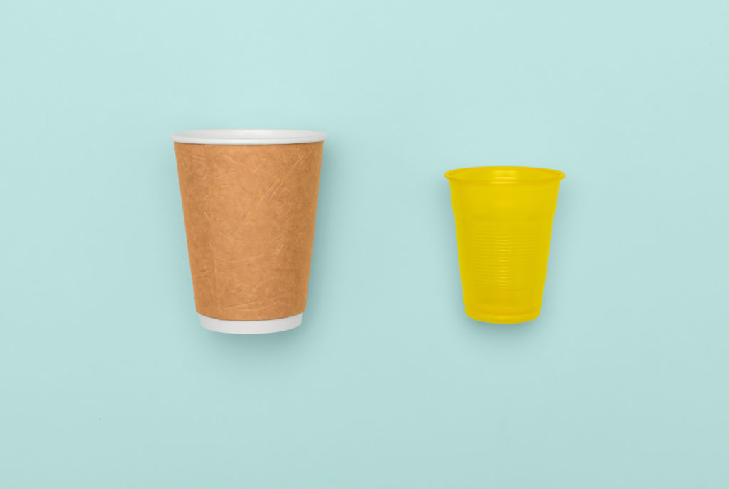 Plastic and paper cups in contrast