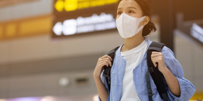 Asian travelers girl with medical face mask to protection the coronavirus in airport