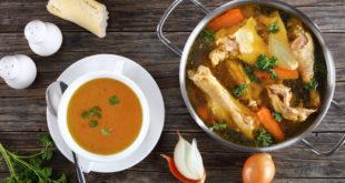 clear Chicken broth in a pot and bowl brodo di pollo