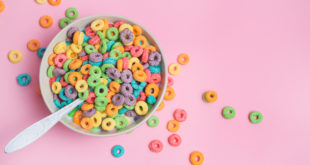 Colorful cereal on a pink background