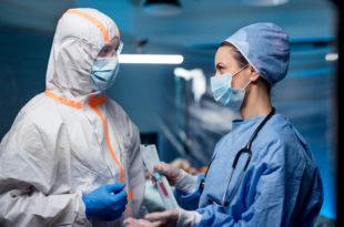 Doctors holding samples in hospital, coronavirus concept.