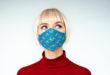Pensive, thoughtful woman wearing protection handmade face mask during the quarantine of coronavirus infection outbreak. Copy, empty space for text mascherine