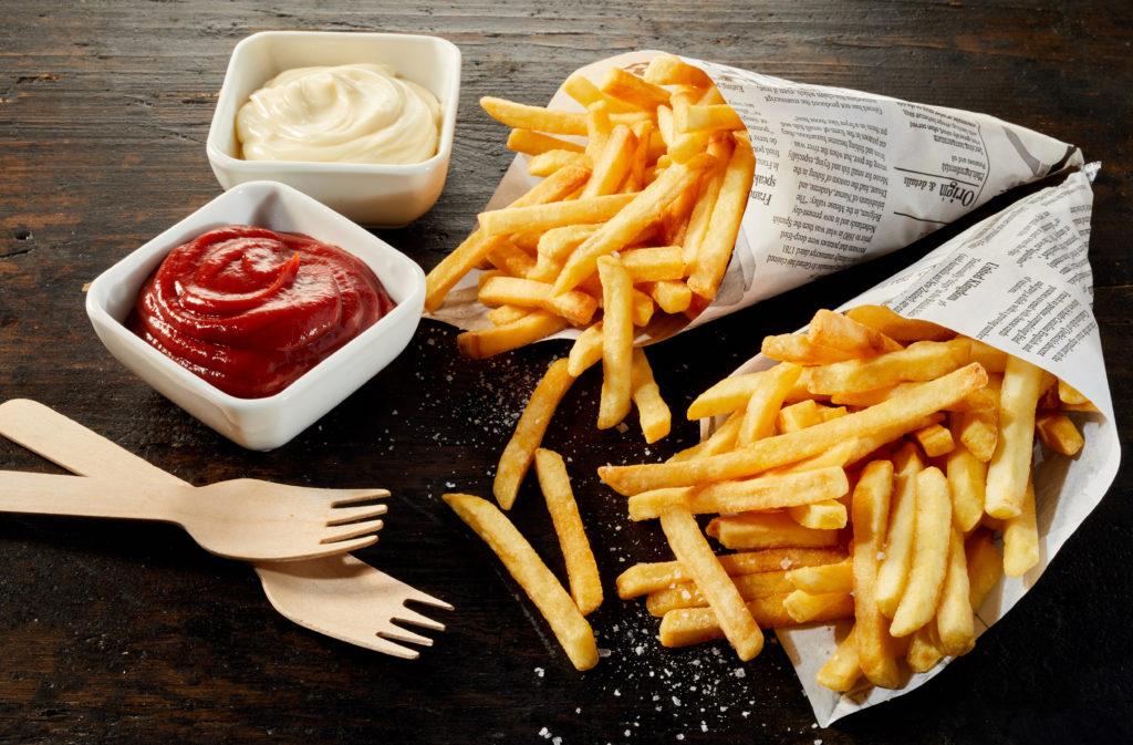 Takeaway servings of deep fried potato chips