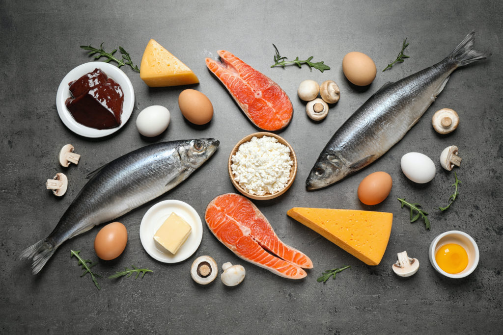 resh products rich in vitamin D on grey table, flat lay