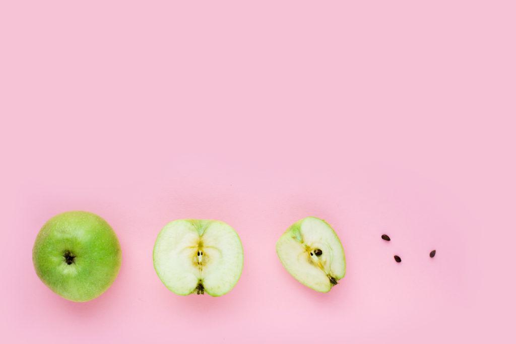 Green apple, half apple and quarter apple