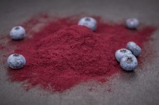 Some Blueberry Powder on a dark slate slab