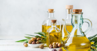 Assortment of fresh organic extra virgin olive oil in bottles