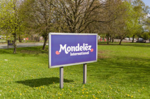 Mondelēz International sign outside the cocoa bean processing factory where chocolate is made in the UK